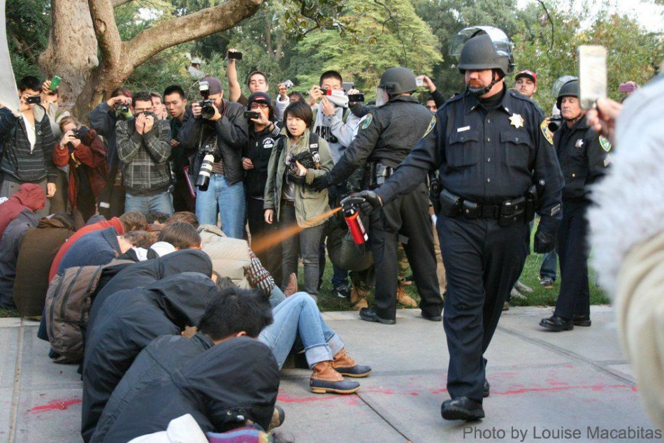 files/images/uc-davis-police-lt-john-pike-dousing-seated-students-with-pepper-spray.jpg